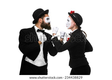 Two memes as businessmen fighting for being the boss, isolated on a white background. concept  of struggle for power - stock photo
