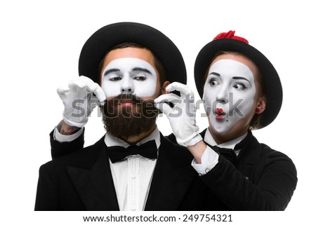 Two memes as businessmen. woman making a face man adjusting his mustache, isolated on a white background. Conceptual sense - the ability to keep a person