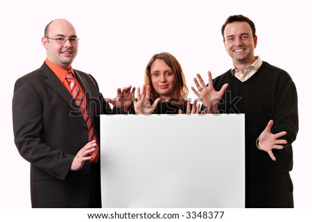 Two men and a woman holding a blank  with the hands in the air isolated on a white background. - stock photo
