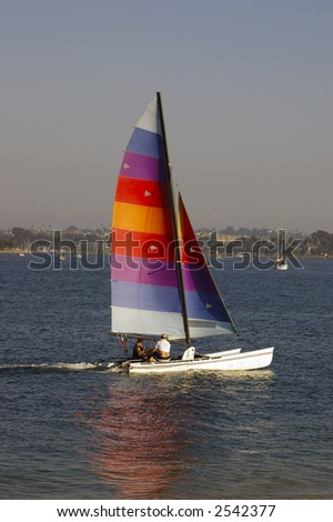 Two men are sailing in Mission Bay, San Diego, California.