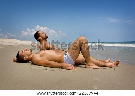 Two men at the beach - stock photo