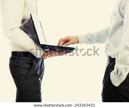 Two men at work using computer - stock photo