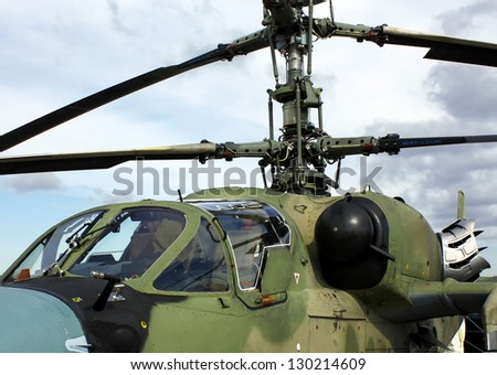Two men cabin of the Russian attack helicopter - stock photo