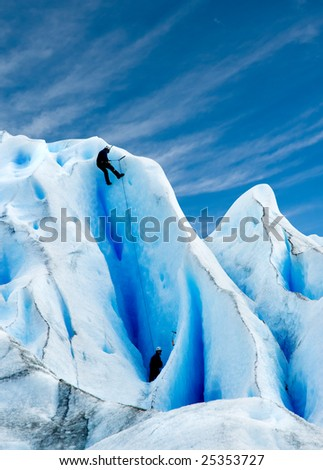 Two men climbing a glacier in patagonia. - stock photo