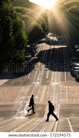 Two men crossing the road - San Francisco, Hyde Street - stock photo