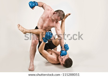 Two men fighting on a white background - stock photo