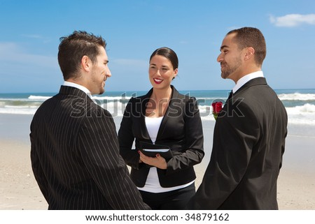 Two men getting married on a beach - stock photo