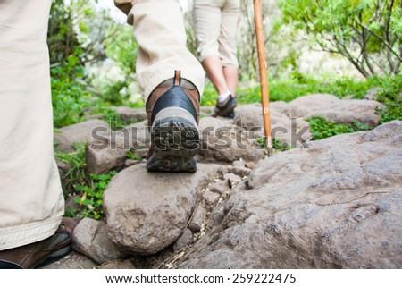 two men hiking - stock photo