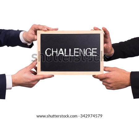 Two men holding mini blackboard with CHALLENGE message - stock photo
