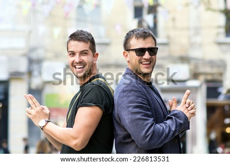 Two men in a pistol duel back to back - stock photo