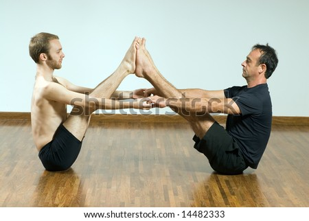 Two Men In A Yoga Pose