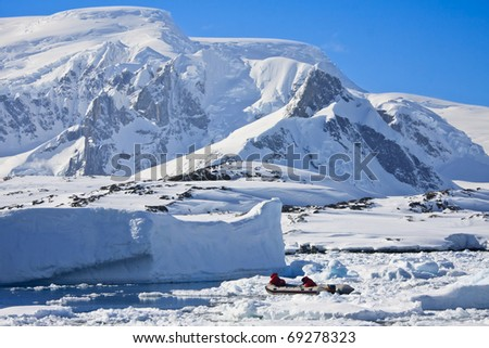 two men in the boat in Antarctica fishing - stock photo