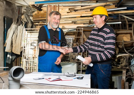 two men in the production of - stock photo