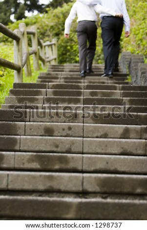 two men just married walking up steps - stock photo