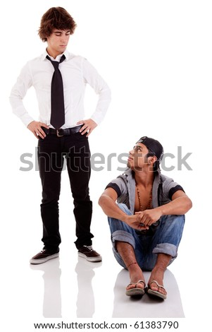 two men of different ethnicity, one sitting looking at the other standing, isolated on white, studio shot - stock photo