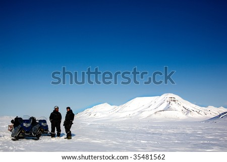 Two men on a snowmobile trip on Svalbard, Norway