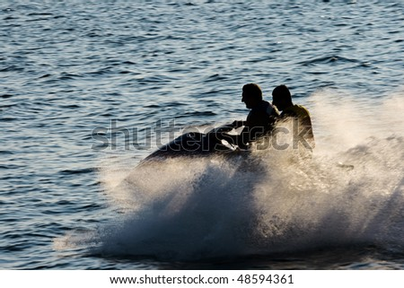 Two men on a water bike - stock photo
