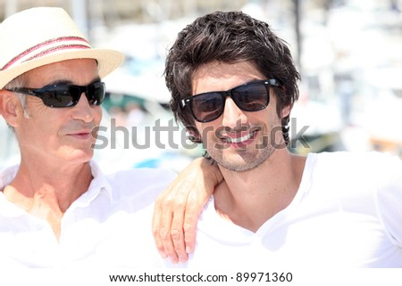 Two men on summer holiday together - stock photo