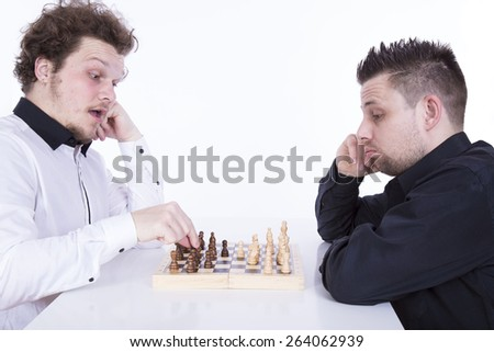 Two men playing chess on the white background