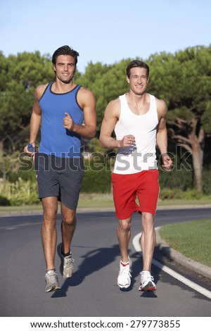 Two Men Running On Road - stock photo
