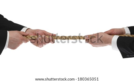 Two men's hands tugging rope on white background - stock photo