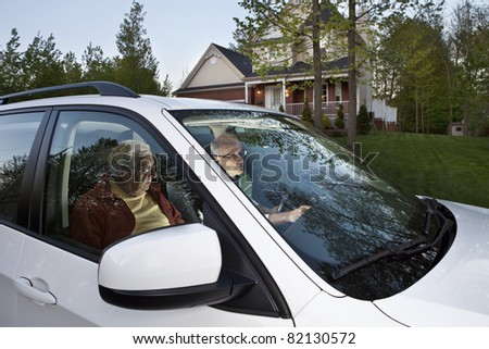 Two men setting GPS before carpooling from home - stock photo