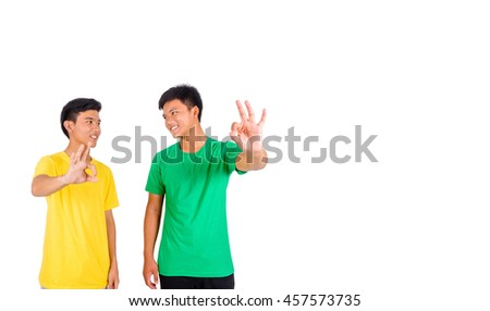 Two men show OK sign and smile to each other - stock photo