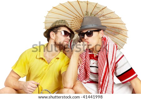 two men sitting in a summer dress - stock photo
