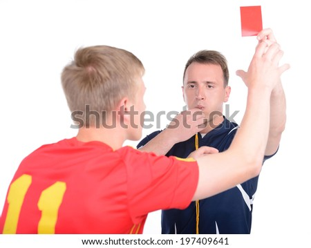 Two men soccer player and referee showing red card on white background - stock photo