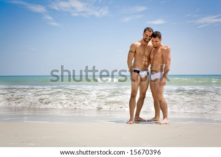 Two men standing at the beach - stock photo