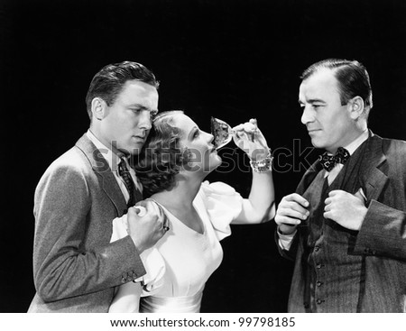 Two men supporting a woman drinking - stock photo