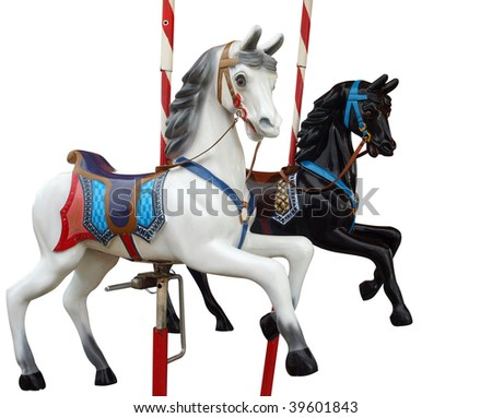 Two Merry-Go-Round Horses isolated with clipping path - stock photo