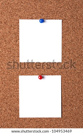 Two message papers pinned to cork board - stock photo