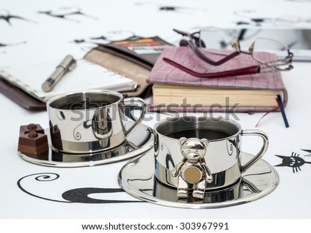 two metal cups of coffee a notepad on a bed. bedroom, interior, morning businessman