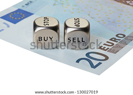 Two metal dices with words Buy and Sell on twenty-euro banknote, isolated on white background. Selective focus
