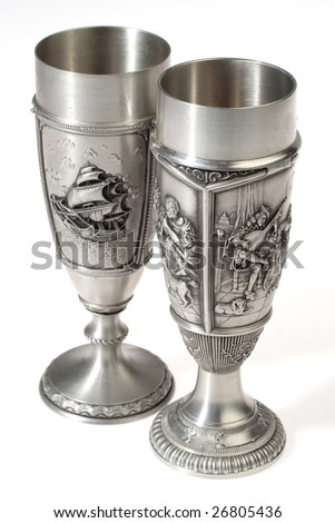 Two metal european wine goblets over white background - stock photo