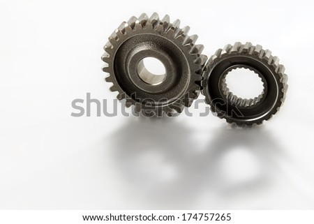 Two metal gears on plain background - stock photo