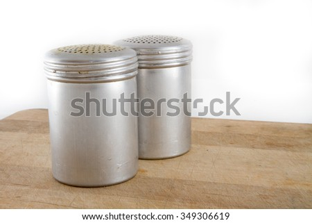 Two metal salt and pepper shakers to be used for food - stock photo