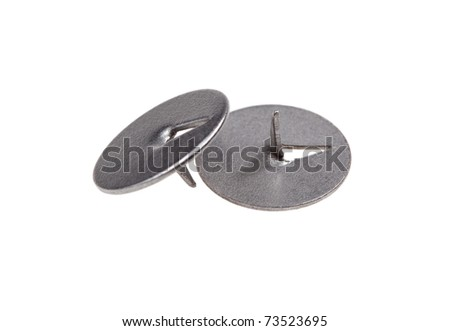 Two metal thumbtacks. Isolated on white.