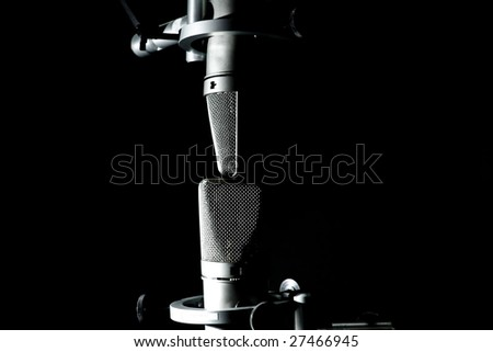 Two microphones, one straight up and one upside down,with a slight DOF - stock photo
