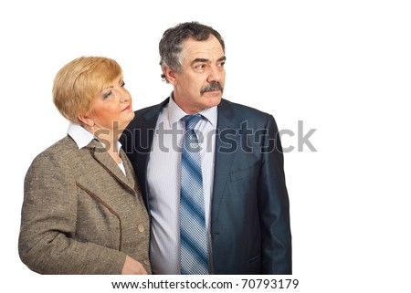 Two middle aged business people looking away to copy space and thinking at perspectives for future isolated on white background - stock photo
