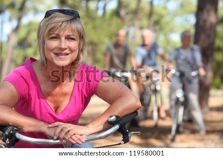 Two middle aged couple on bike ride - stock photo