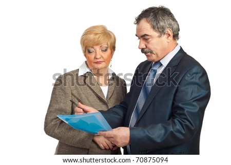 Two middle aged executives people reading contract isolated on white background - stock photo
