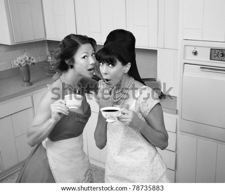 Two middle-aged retro styled women gosipping while having coffee