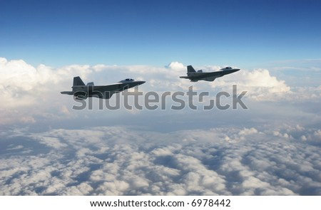 Two military jets flying together high above the clouds with a dark blue sky.