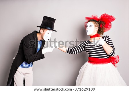 Two mime, pantomime kiss, valentine day concept, April Fools Day concept - stock photo