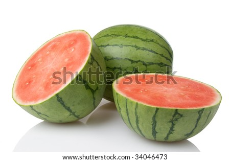Two mini watermelons with one sliced in half - stock photo