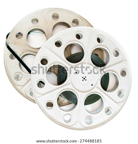 Two 35 mm cinema movie reels with film isolated on white background - stock photo