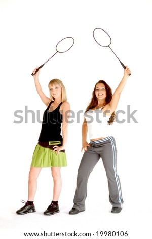 Two models with badminton rackets. - stock photo