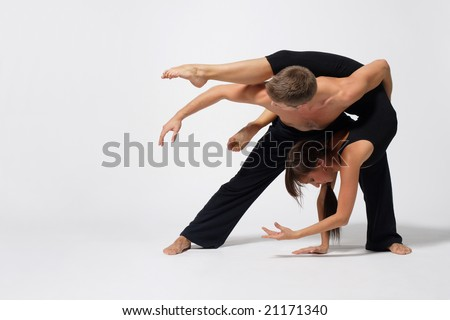 two modern ballet dancers posing on white - stock photo